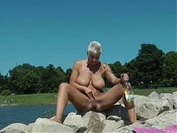 Nude Beach - Big Boob Mature Plays Up